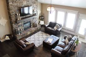 living room with rock faced fireplace