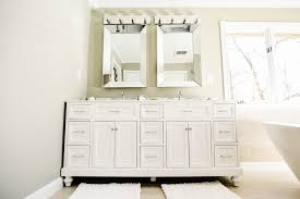 bathroom sink lighting. white glazed bathroom sink vanity and cabinets lighting