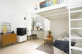Small Swedish studio apartment elegantly bines loft bed and