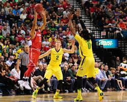 Utah guard Isaiah Wright (1) jumps to pass in front of Oregon forward  Dwayne Benjamin (0) and guard Casey Benson (2) in the first half of the Pac  12 Conference tournament championship