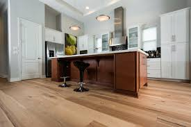 wire brushed natural hickory wood flooring in kitchen with black retro stools