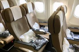each seat had a remote operated on demand in flight entertainment screen that offered s tv shows and a flight map