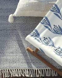 new can outdoor rugs get wet coastal blues and whites teak camp stool and outdoor rug