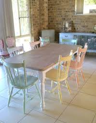diffe color chairs in craft room