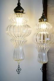 the rose medium and large hand blown glass pendant lights side by side