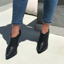 pointy toe black leather booties