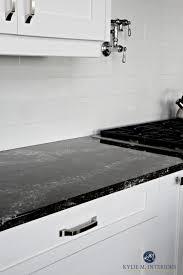 cambria ellesmere black quartz countertop white kitchen cabinets and off white light gray subway