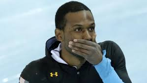 Shani Davis of the U.S. covers his mouth after competing in the men's 1,500-meter speedskating race at the Adler Arena Skating Center during the 2014 Winter ... - shani-davis-ap105860377110