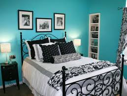 blue wall girls blue room ideas with black bed frame on the wooden floor can add