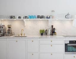 marble countertops and backsplash in a kitchen from per jansson via seventeendoors granite countertop alternatives e45 countertop