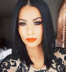 silver liner on brown eyes with orange lipstick