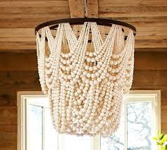 amelia indoor or outdoor ivory wood bead chandelier potterybarn com