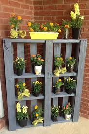 flower garden ideas designs. paint an old pallet and show off your favorite flowers near front door or in a corner of garden. the vertical display takes up very little space, flower garden ideas designs i