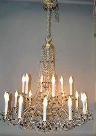 large silver and crystal chandelier light fixture with