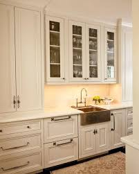 a gleaming copper sink makes this space shine notice all the diffe hardware styles incorporated here and how mixing pulls and s adds visual