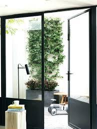 metal frame doors with glass interior steel door steel framed glass doors open to a courtyard
