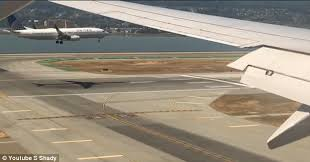 parallel planes in sports. the plane to left is clearly identifiable as a united airlines aircraft. carrier parallel planes in sports