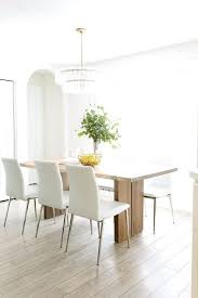 monarch natural solid walnut dining table with white chairs crate and barrel dakota bench