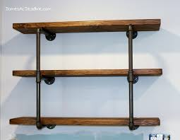 using iron pipe thick wood planks spray paint and stain i created the