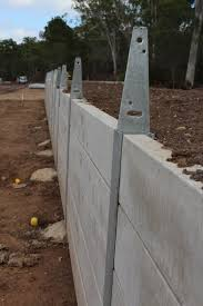 wood retaining wall ideas big pioneer smooth grey concrete sleepers steel posts with fence