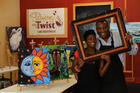 painting with a twist franchise owners kermie left and algy irvin show off