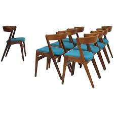eight danish curved back dining chairs