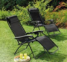 black outdoor chairs and loungers