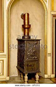 stove vent pipe. woodburning stove with copper vent pipe - stock image