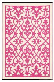 pink indoor outdoor rug woven from straws made up of recycled plastic washable just shake or