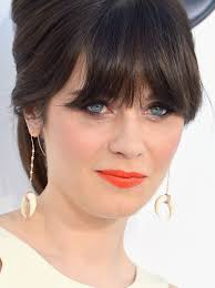 zooey deschanel swept on a sparkly citrus shade of lipstick for the 2016 billboard awards