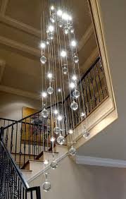 interesting chandelier foyer foyer lighting low ceiling stair white color frame painting decoration