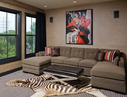 glamorous animal skin rugs in home theater eclectic with next to alongside and