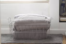 Eye Catching White Iron Towel Storage For Minimalist White Bathroom
