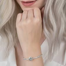 pandora signature branding encircling a heart shape which is set with pave cubic zirconia around the edge of the charm a pattern of cut out hearts