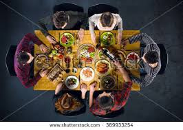 dinner table top view. top view creative photo of friends sitting at wooden vintage table. six having dinner table