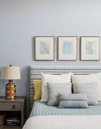 blue and gray cottage boy s bedroom features silver gray walls painted benjamin moore silver half dollar lined with a trio of framed maps placed over a