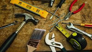 handyman tools, hammer, paint brush, pliers