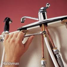 replace a sink sprayer and hose the family handyman inside kitchen sink faucet with sprayer intended