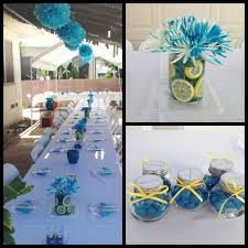 Outdoor Baby Shower Decorationsyellow lemons, with white flowers and a  grey ribbon