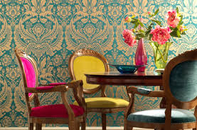 colorful dining room with multicolored chairs 10