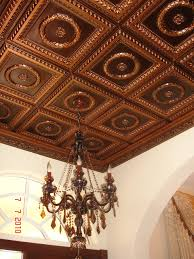 sagging tin ceiling tiles bathroom: interesting ceiling decoration with brown faux tin ceiling tiles plus pretty chandelier and white wall