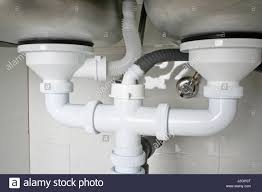 Drain Pipes Under A Kitchen Sink With Dishwasher Connection Stock