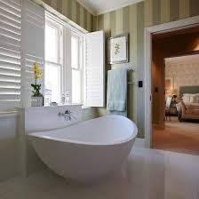 en suite bathroom white en-suite bathroom with green stripe wallpaper  GDCJVPH