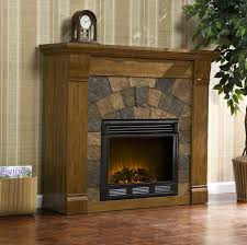 interior rustic stone fireplace which decorated with white burning electric surrounds combined dark varnished oak mantel