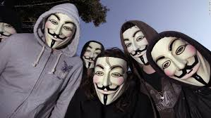 protesters in guy fawkes masks favored by the anonymous hackers group pose at