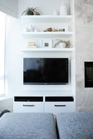 three floating shelves over wall mount tv