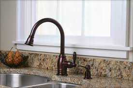 enhance the look and functionality of your kitchen sink with oil rubbed bronze kitchen faucet