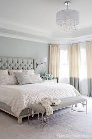 Relaxing Bedroom Colors: smoky blue bedroom paint walls, crystal drops  chandelier, ivory and