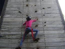 climbing up on artificial rock climbing wall in mumbai with mountain man makes rock climbing walls for concrete jungles