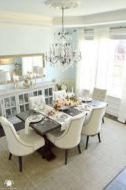elegant blue dinning room with crystal chandelier and restoration